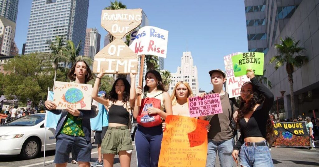Young kids holding signs in protest