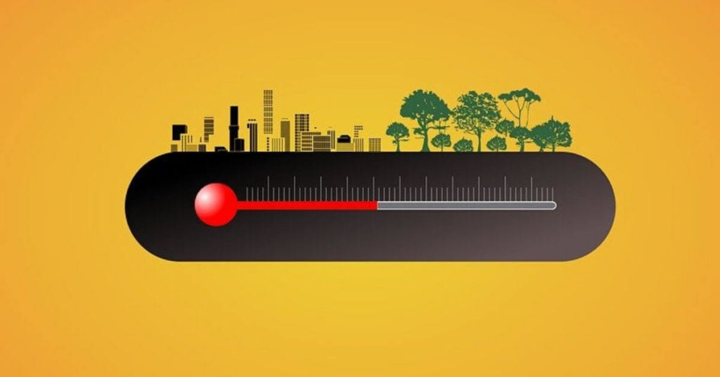 Stylized photo of a thermometer, a city, and trees