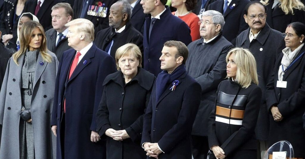 Trump standing among a crowd of world leaders