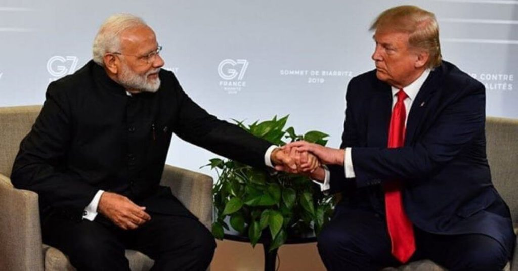 Trump shaking hands with Modi