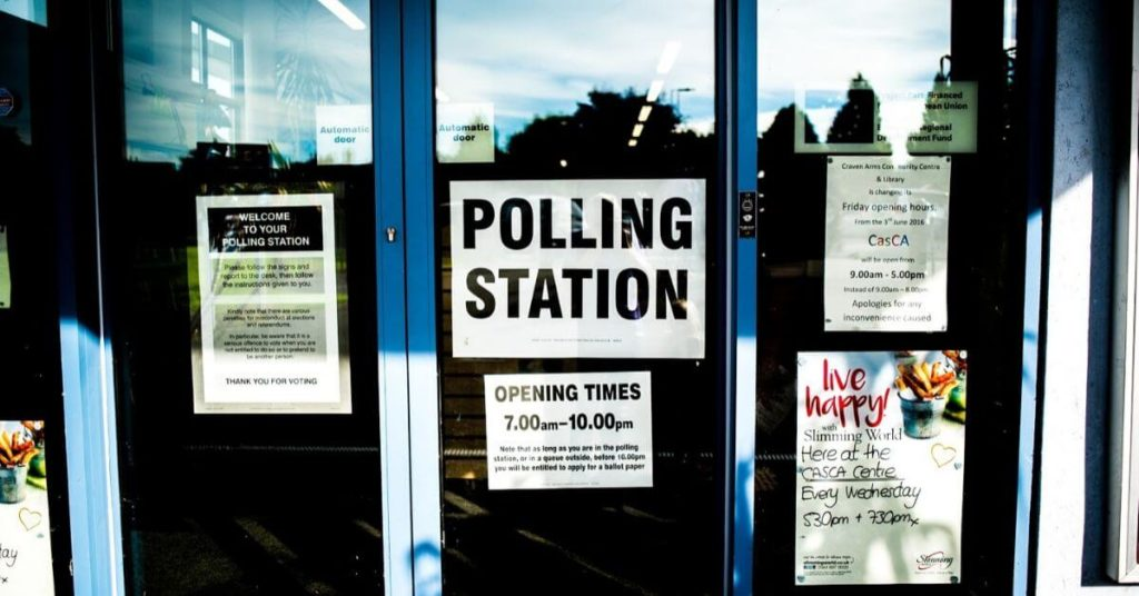 A photograph of a voter polling station.