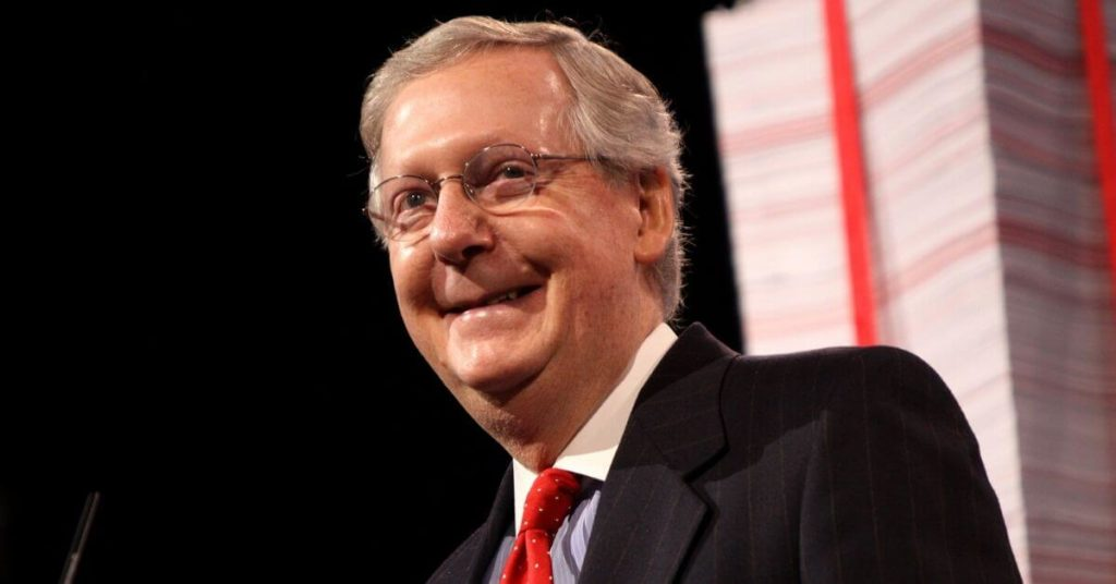 Mitch McConnell smiling