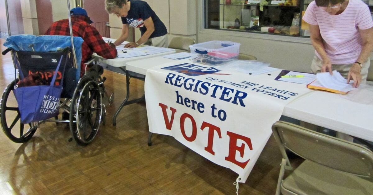 Voter registration table man in wheelchair