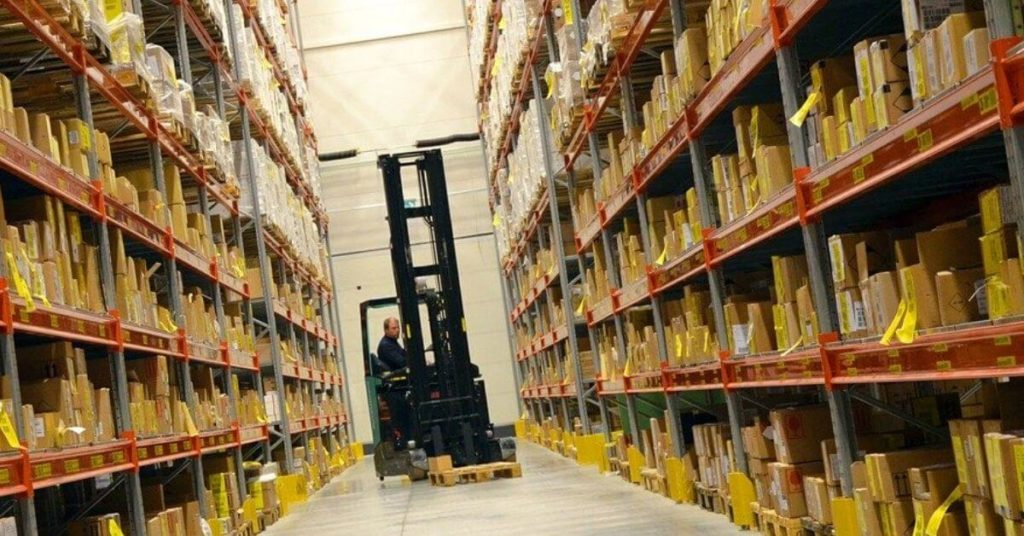 Man on a Hyster in an Amazon warehouse
