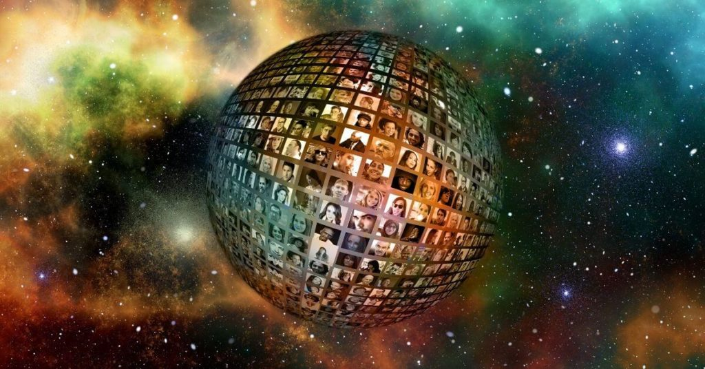 An image of a glitter ball made up of television screens.