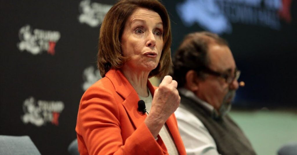 Nancy Pelosi holding up her fist