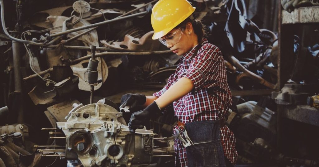 Female factory worker in a hard hat