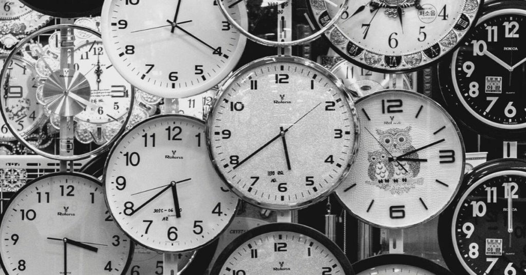 Flatlay photo of numerous clocks