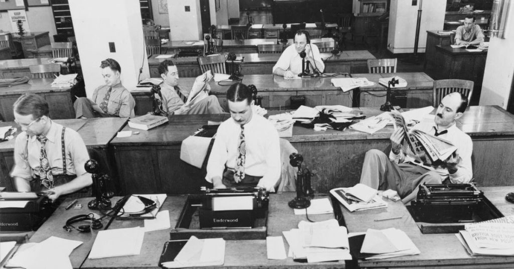 Vintage photo of reporters in a news room