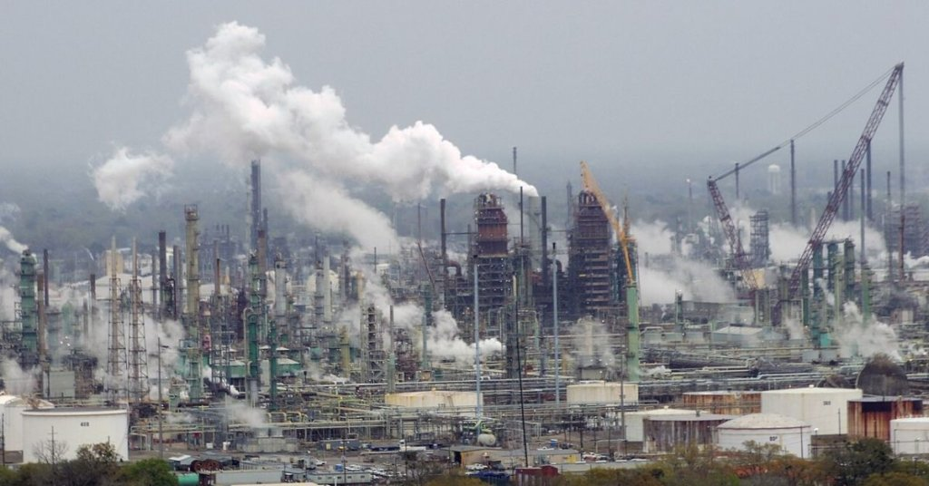 View of an oil refinery spewing pollution into the air