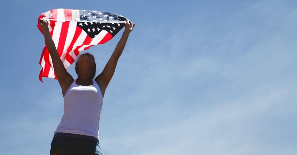 A person holding an American flag