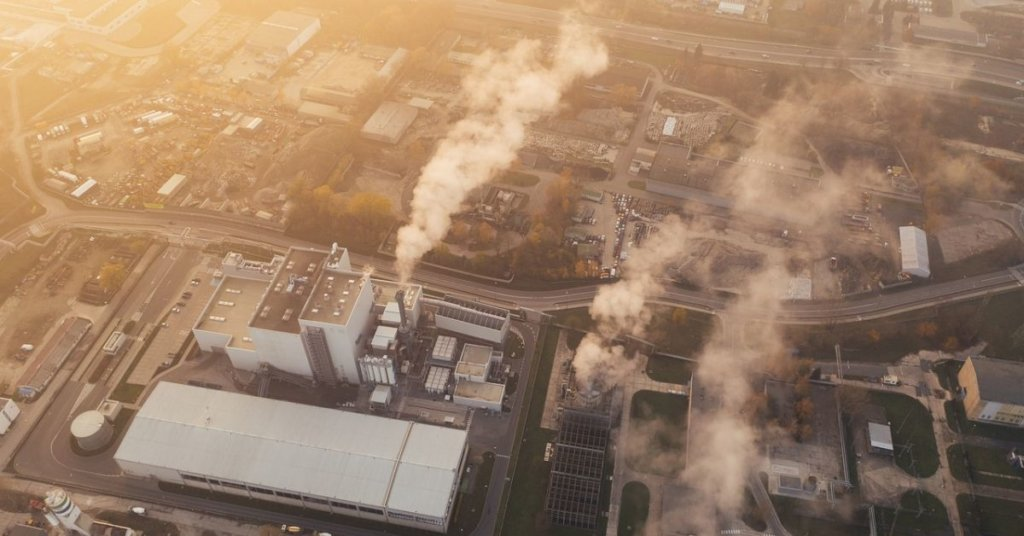 Aerial view of factory spewing fumes