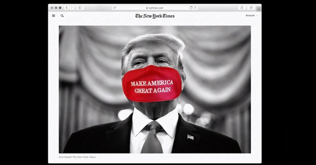A black and white photograph of Donald Trump with a red mask added to his face. The mask reads Make America Great Again.