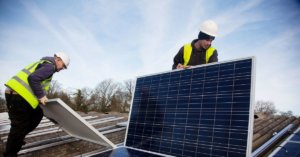 Two men working with solar panels