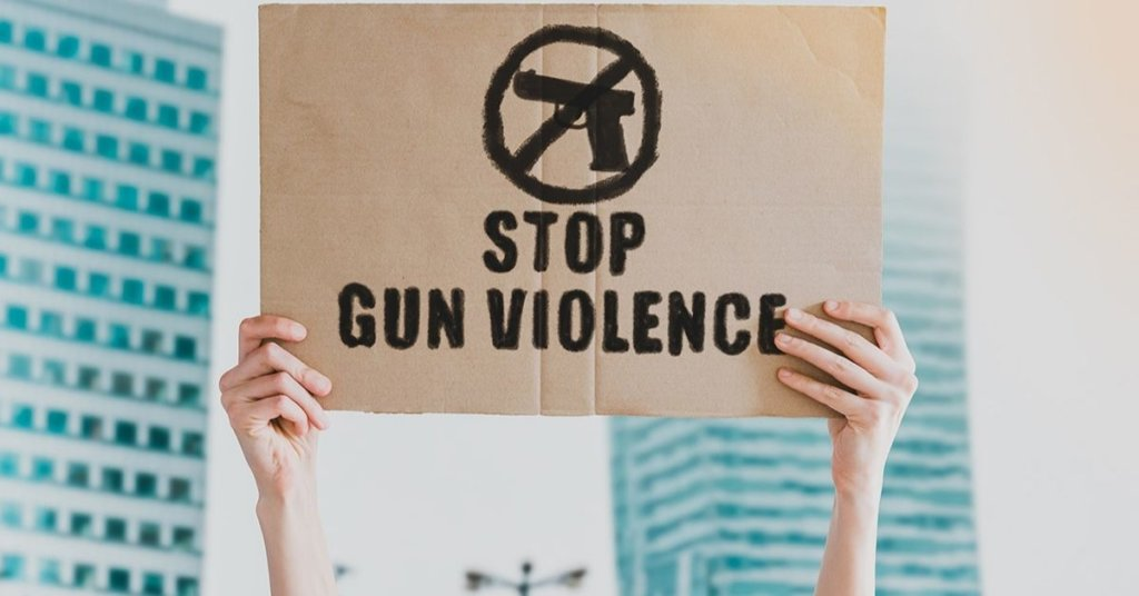 Person holding a stop gun violence sign