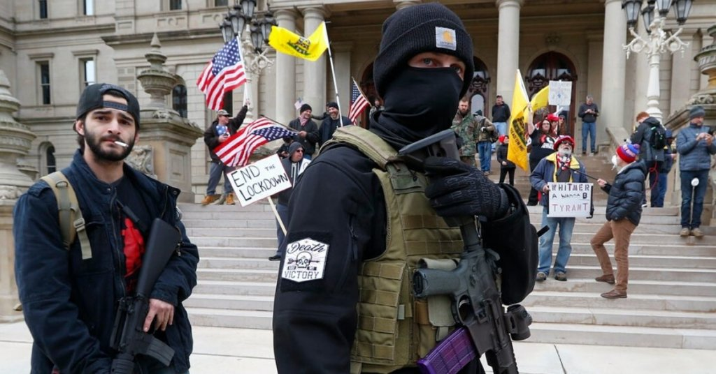 Anti-lockdown protestors holding automatic rifles