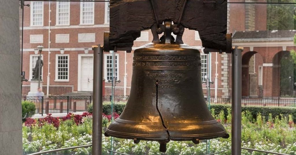 liberty bell with building in background