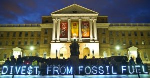 descriptive image of divest from fossil fuels illuminated signage