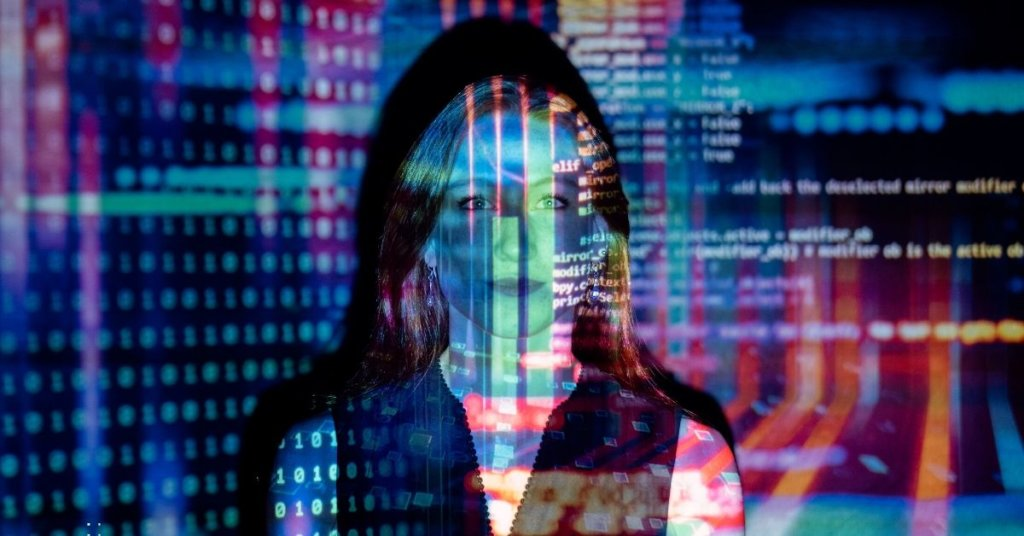 Stylized photo of woman covered in computer code