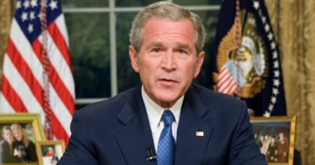 George W Bush giving a speech from the Oval Office