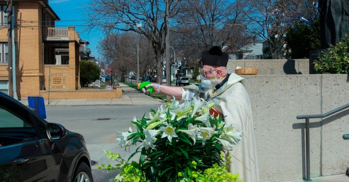 The story of the Metro Detroit priest blessing his flock with a holy water squirt gun