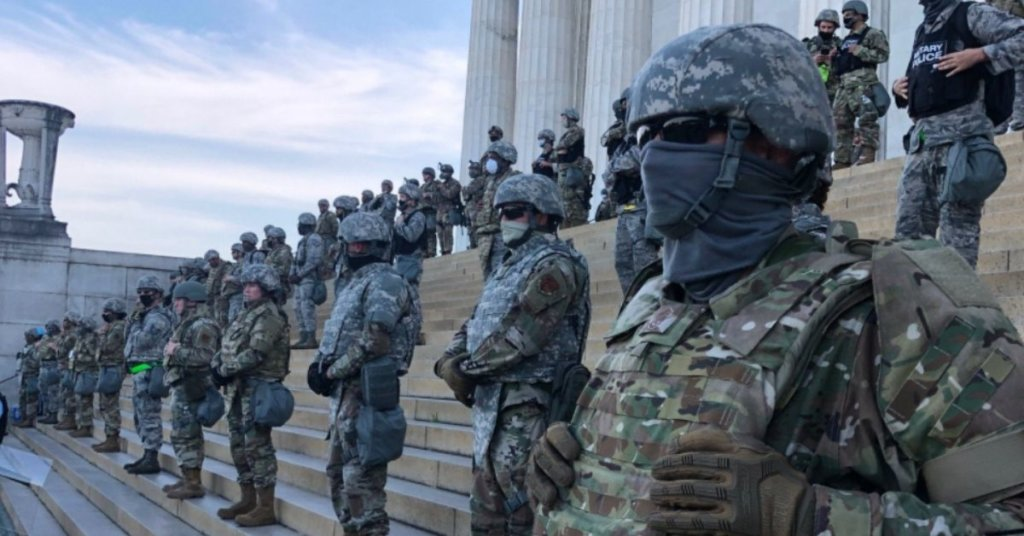 A photograph of National Guard troops blocking access to the Lincoln Memorial.