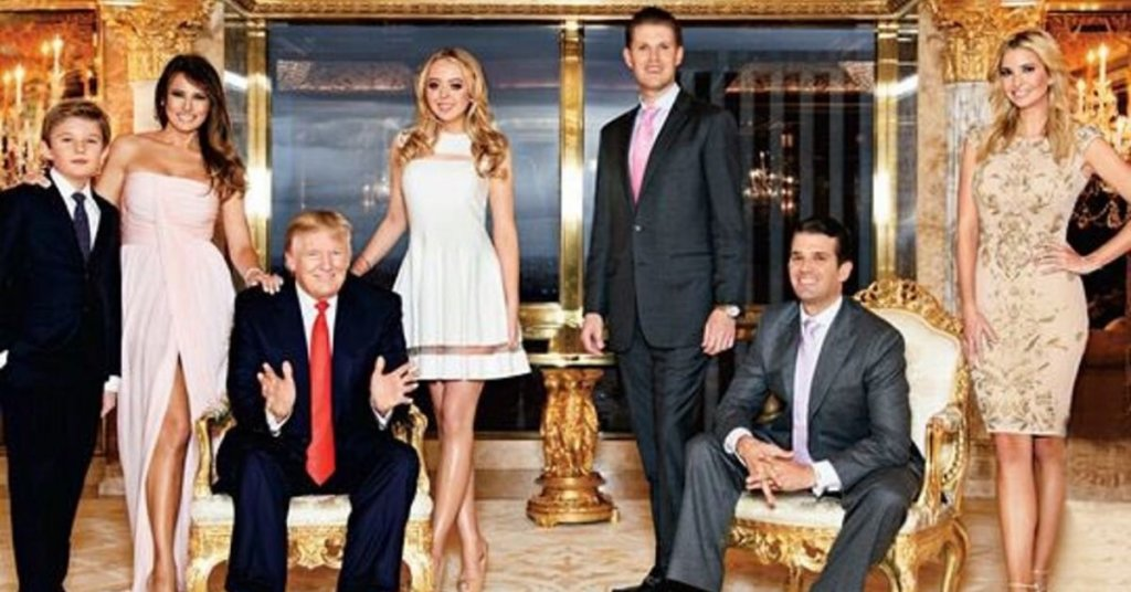 Trump family in a golden room