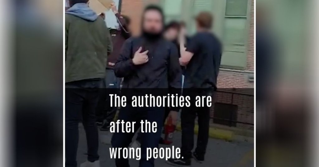 """A screenshot of an activist; captioning reads, """"the authorities are going after the wrong people."""""""