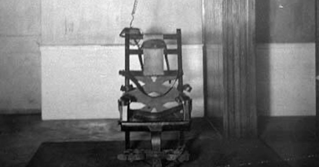 A grainy photograph of the first electric chair