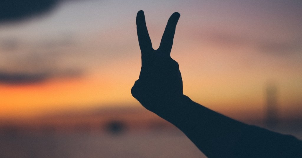 Someone making a peace sign with their fingers