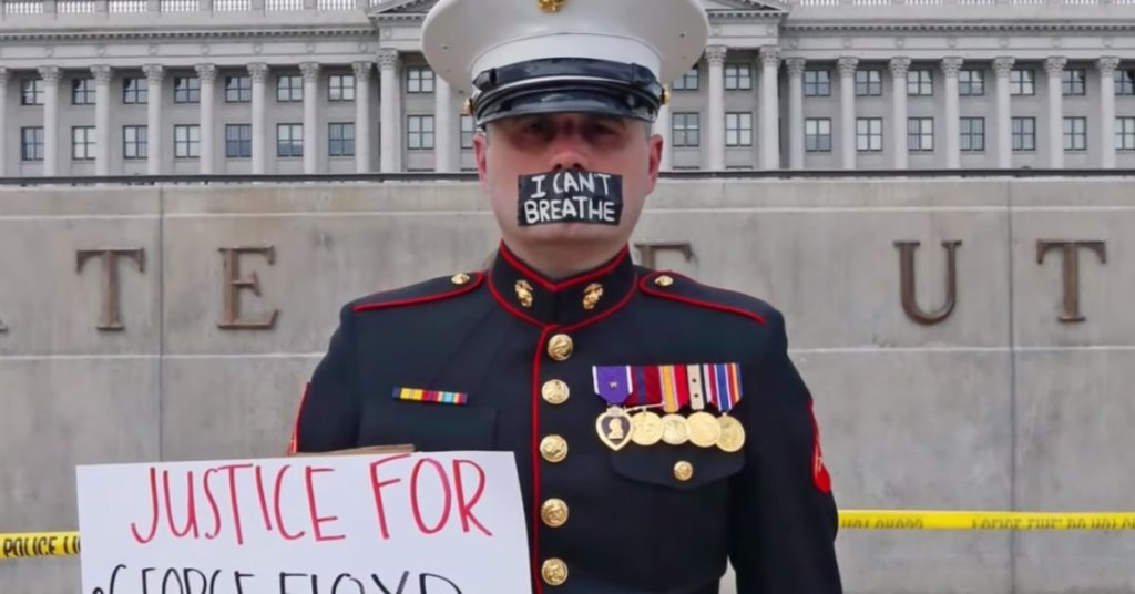 A photograph of Utah Marine Todd Winn protesting in support of Black Lives Matter.