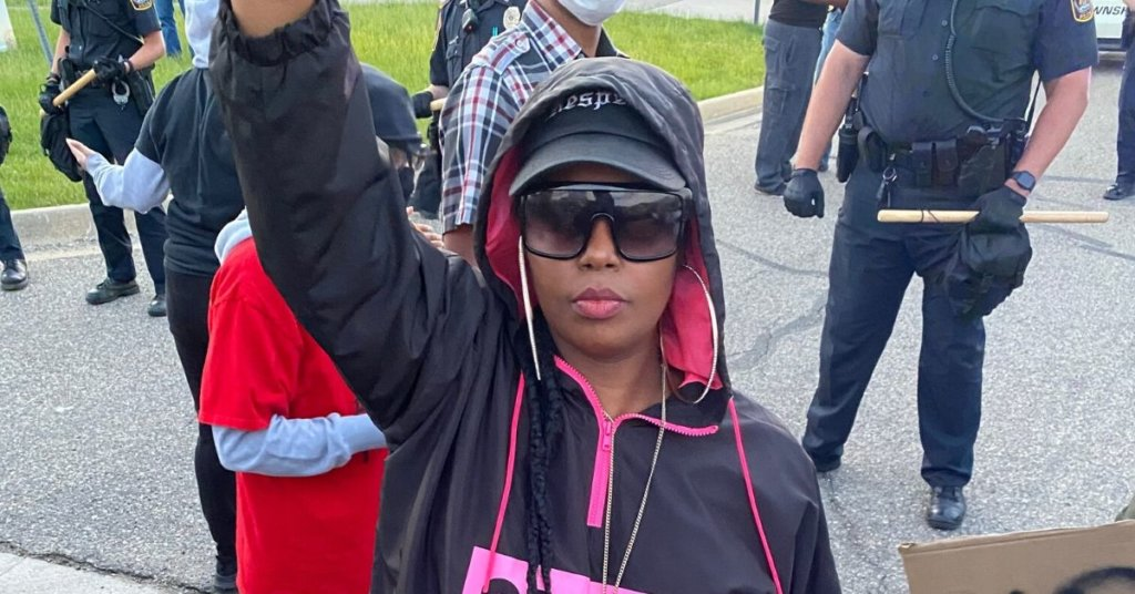 Ramonica Anderson with her fist raised