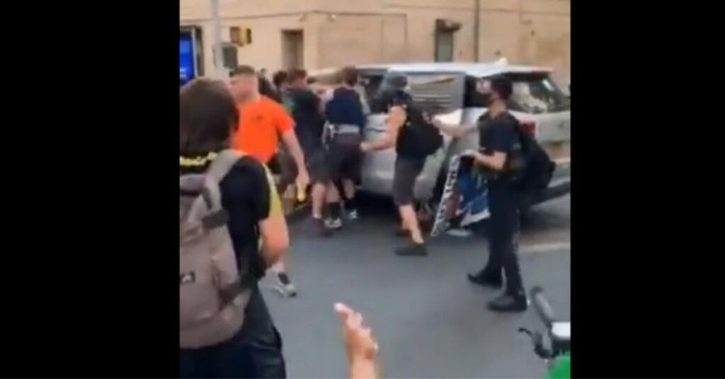 'This is...kidnapping': Video shows plainclothes NYPD officers throwing protester into unmarked van