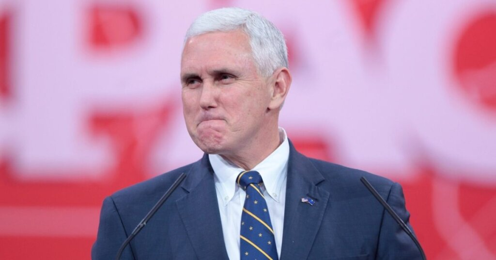 Pence making a grimacing face