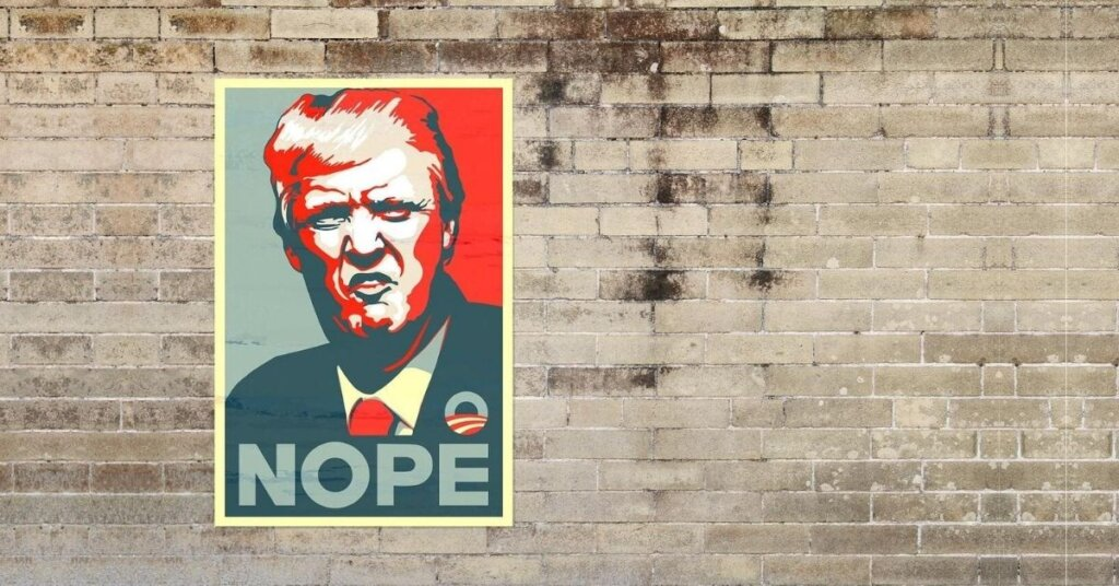 Poster of Trump on a brick wall that says nope