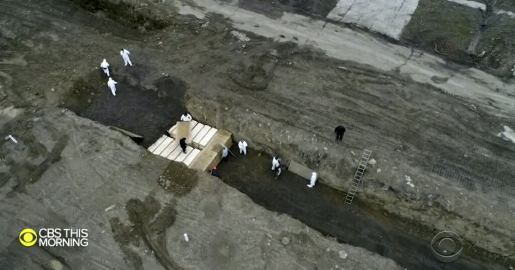 Coffins of coronavirus dead buried two deep in a potters' field in New York.