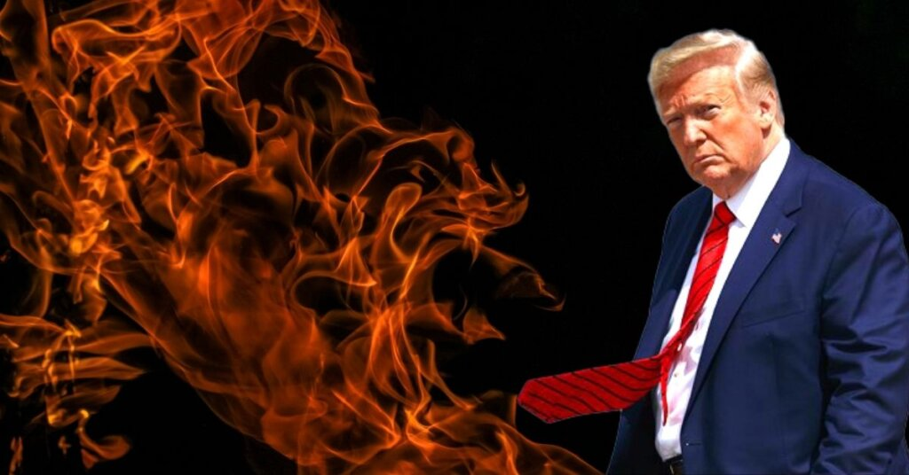 Trump standing in front of a fiery background