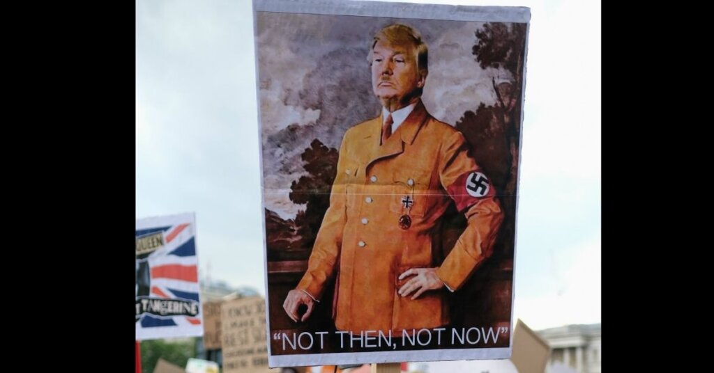 A sign with Trump dressed as Hitler