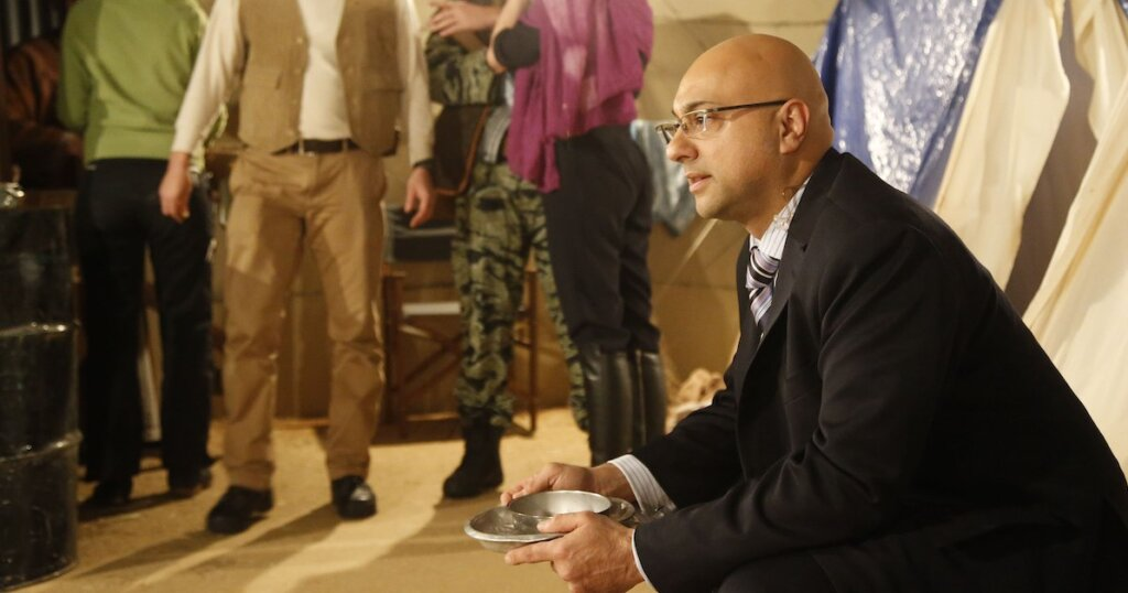 Journalist Ali Velshi on location at a refugee camp.