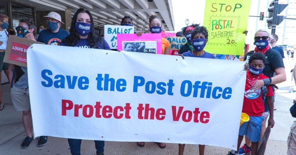 Demonstrators supporting the USPS