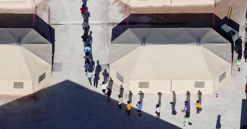 Aerial view of people inside a border camp