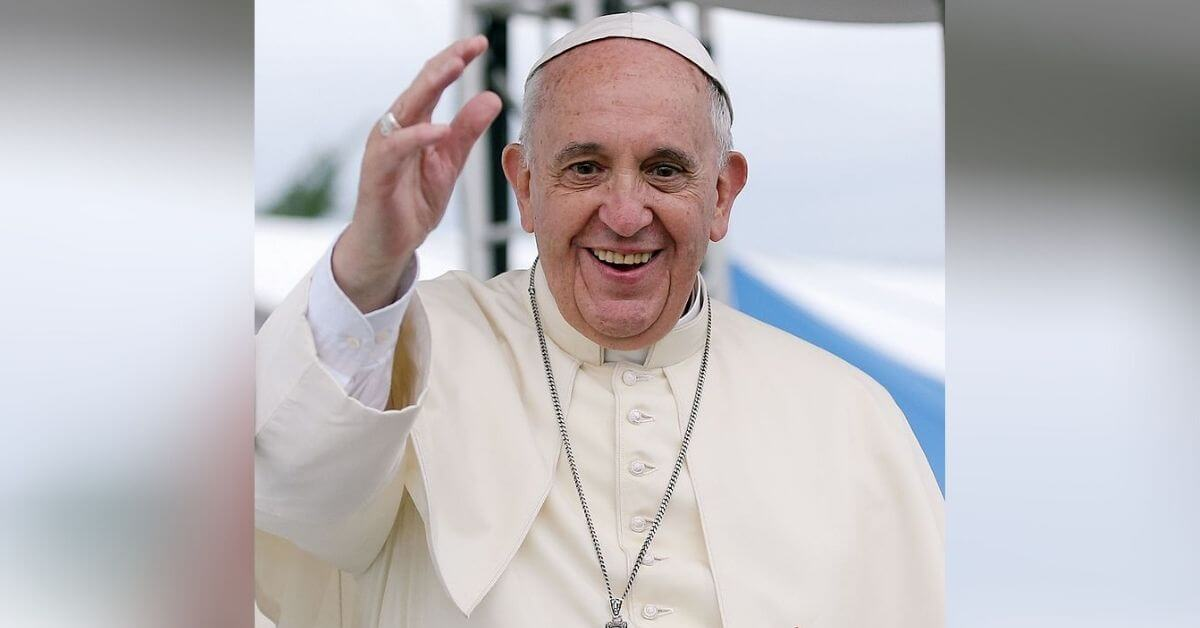Pope Francis smiling and waving to the crowd