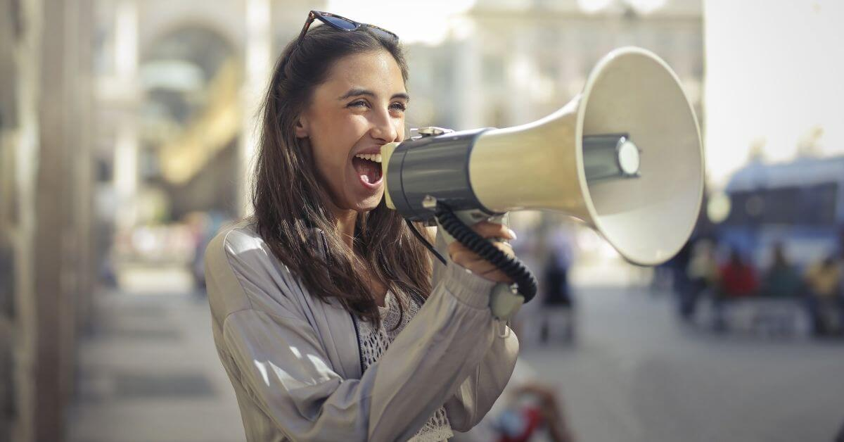 Woman speaking into a megaphone