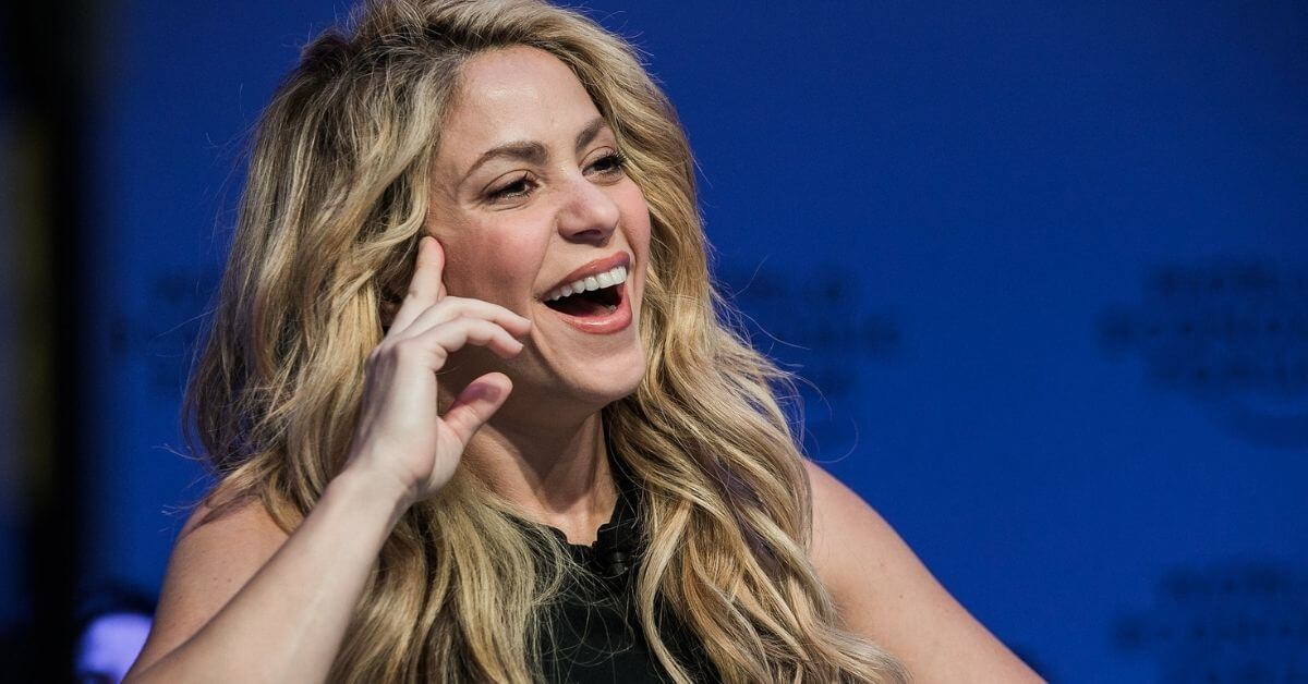 Shakira speaking at an event