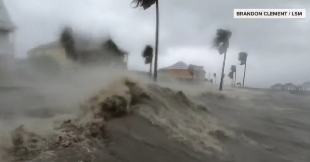 Photo of a shoreline being hit with a hurricane