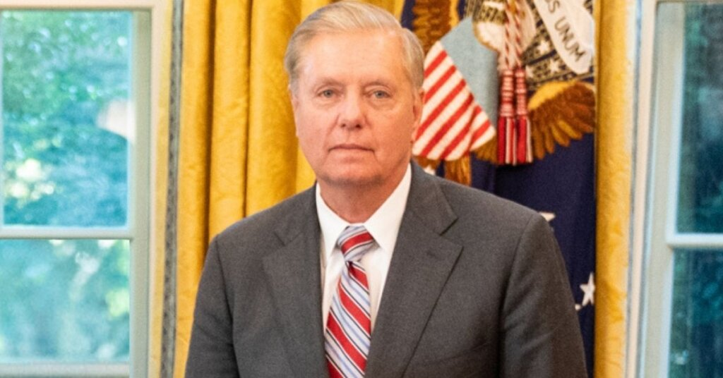 Lindsey Graham standing in the Oval office
