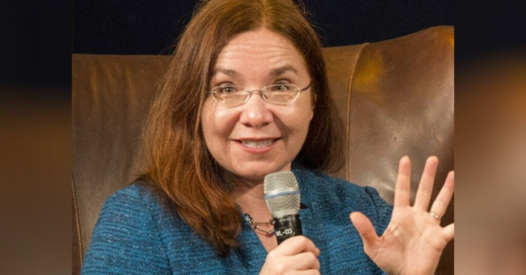 Katharine Hayhoe sitting in a leather chair