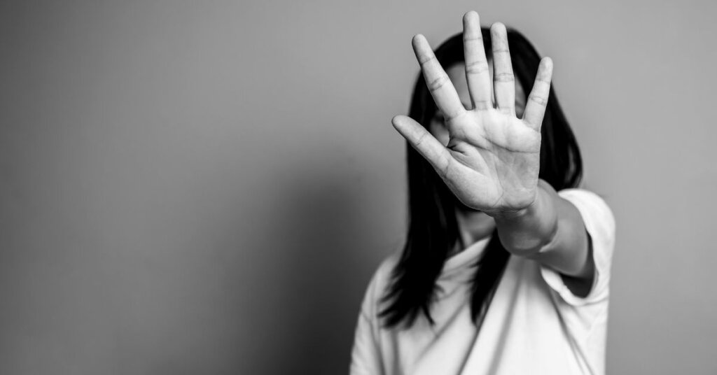 Black and white photo of a woman holding out her hand