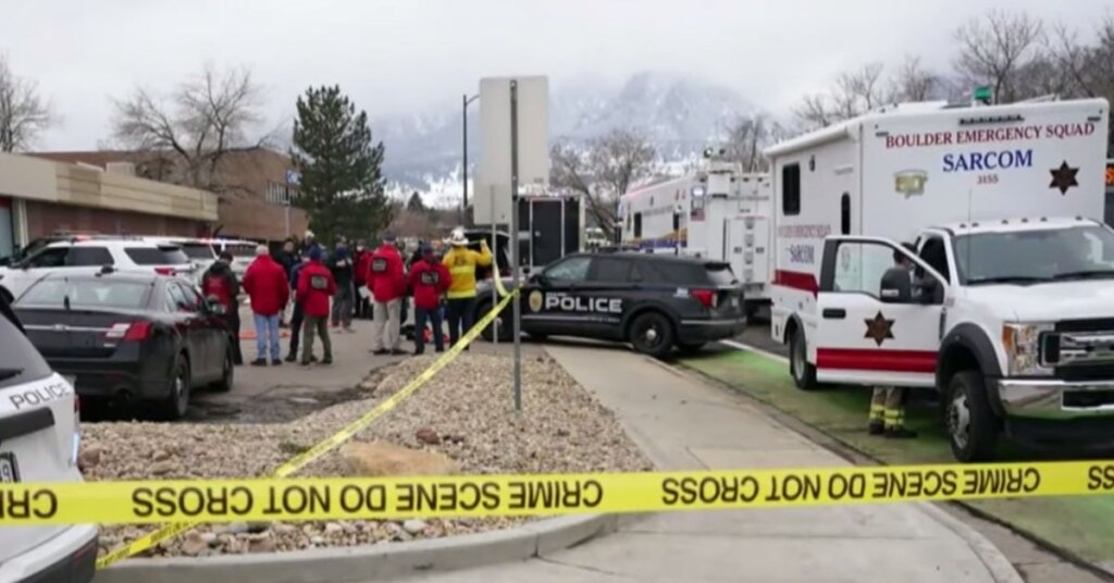 Emergency vehicles parked near the Colorado mass shooting site
