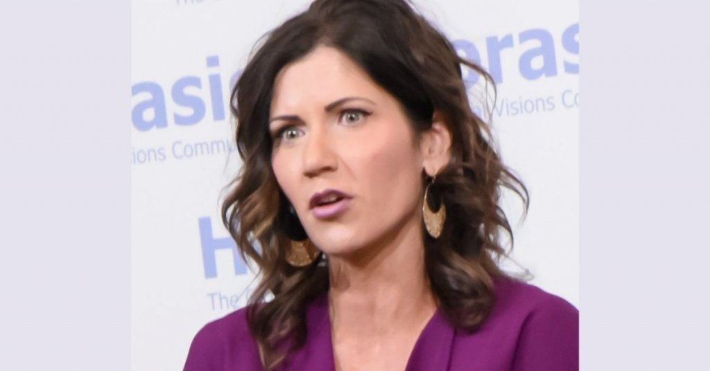 Kristi Noem speaking at an event